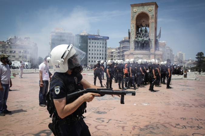 Riot? Check. Gun? Check. Does that mean there's a riot gun in this picture? Read on to find out. (punghi/Shutterstock)