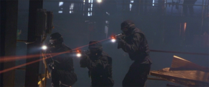 "A SWAT team uses red laser sights in this still from the movie, ""3,000 Miles to Graceland."" (Image via imfdb.org)"