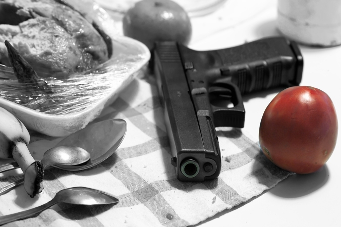 Would you believe there was actually a pic of a gun and a tomato in Shutterstock? I wrote the first paragraph before looking for a pic, and I didn't doctor this photo. Shutterstock is a strange place. (Shutterstock photo)
