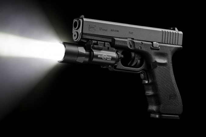 How to use a handgun mounted flashlight